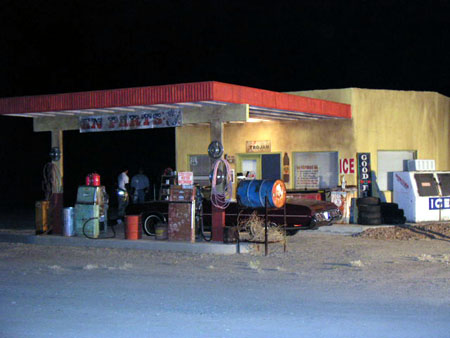 Blue Cloud gas station at night